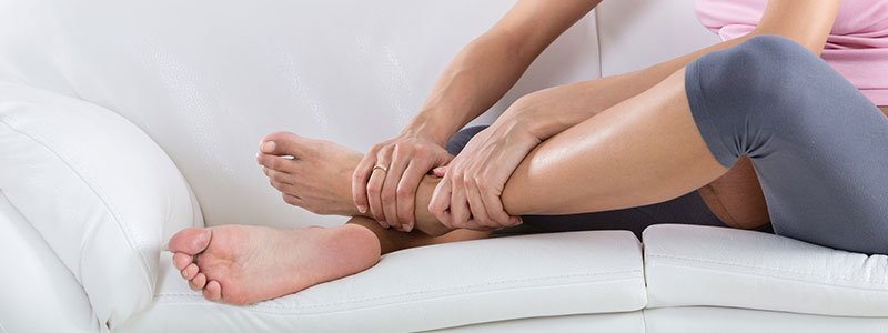 A woman massaging her leg.