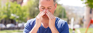 A man with sinus pain.