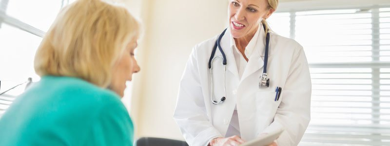 A woman and her doctor reviewing results.