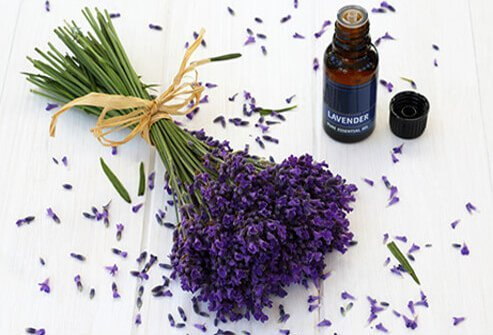 A vial of lavender oil and lavender bouquet.