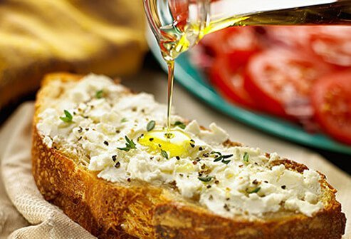 Photo of olive oil drizzled over bread.