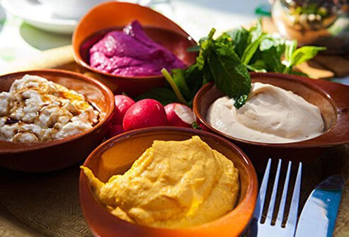 Photo of bowls of hummus and bean dips.