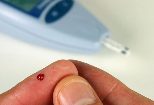 A person checks their blood sugar level.