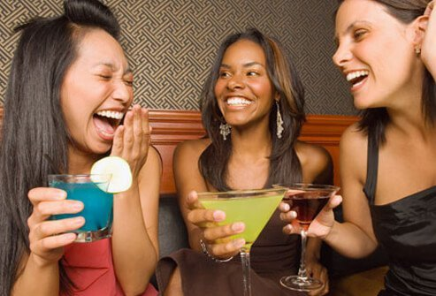 Women having a good time while drinking some mixed cocktails.