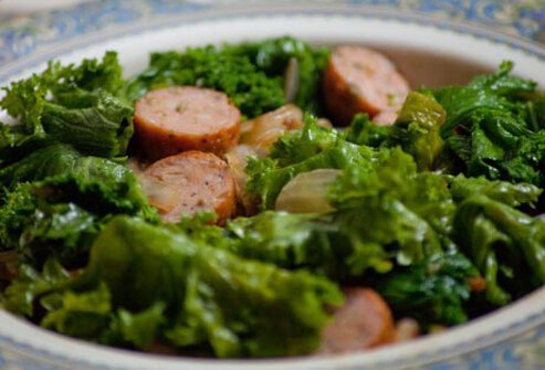 Photo of mustard greens and chicken sausage.