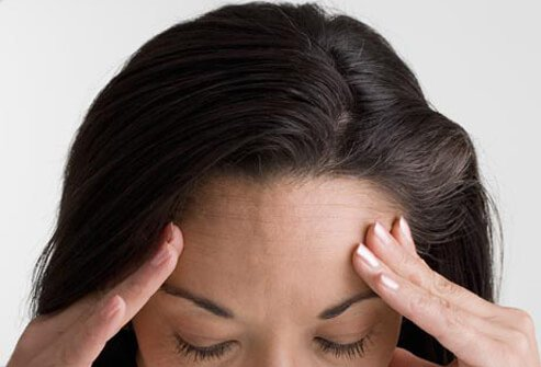 Photo of woman with headache.