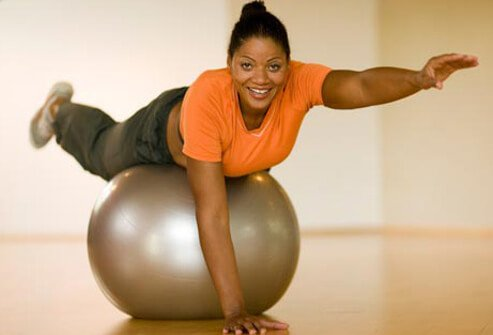 Photo of woman on exercise ball.