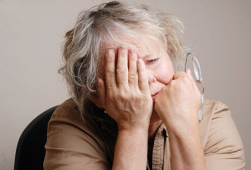 A woman who feels fatigued, a symptom of heart attack in women.