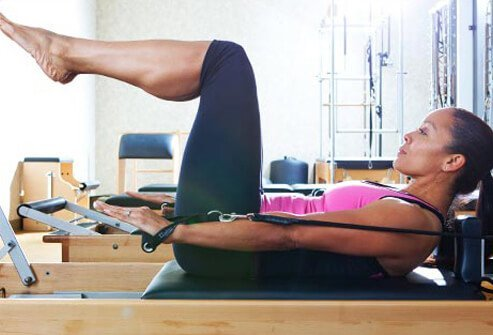 Photo of pilates hundred on reformer.