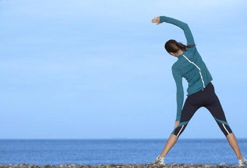 Photo of woman exercising on beach.