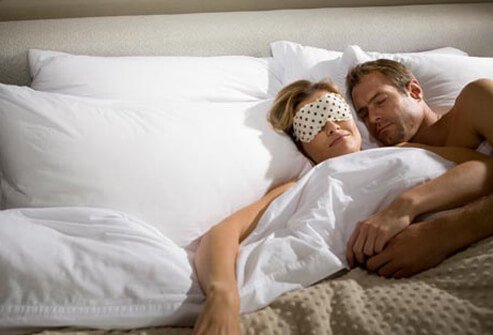 Photo of couple in bed.