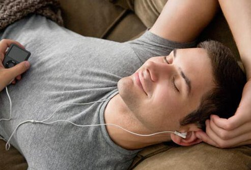Photo of man listening to music.