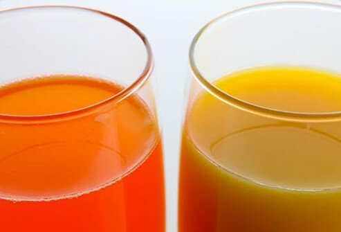 Two glasses of fruit juice.
