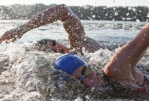 If you've got the guts for a triathlon, but not enough hours to train, try a shorter version.