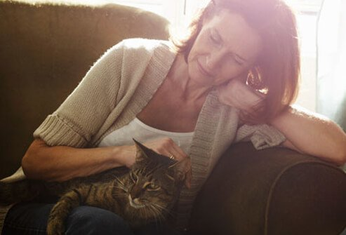 A woman sitting with her cat