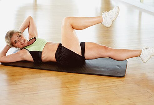 Lying on your back on the floor, fold knees toward the chest and curl the upper body off the floor.