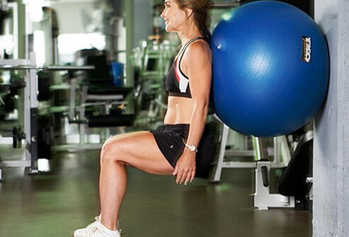 If you're new at this, get started with a beginner version of squats using an exercise ball.
