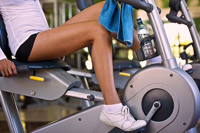You can ride a stationary bike for about 5 minutes, take a brisk 2-minute walk while pumping your arms, or do 15-20 wall push-ups followed by the same number of calf raises.