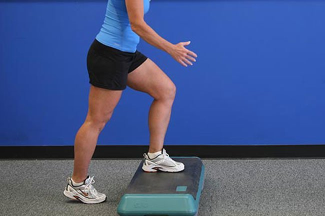 Place one foot on a step bench, platform, or the lowest step on a staircase.