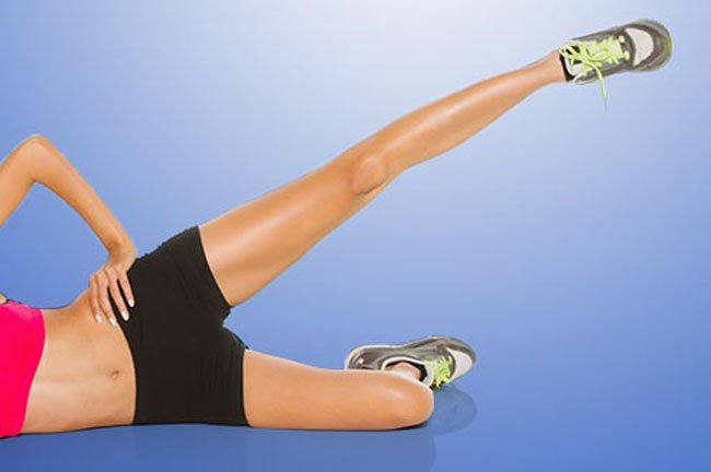 Lie on one side with your legs stacked. Bend the bottom leg for support.