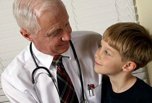 A doctor talks to a boy with ADHD.