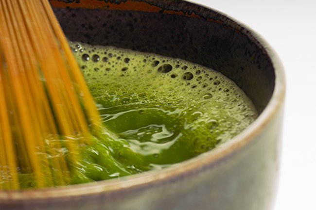 To prepare matcha tea, whisk together boiling water with matcha powder.