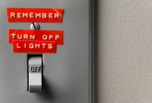 Light switch with a reminder to turn of lights on it.