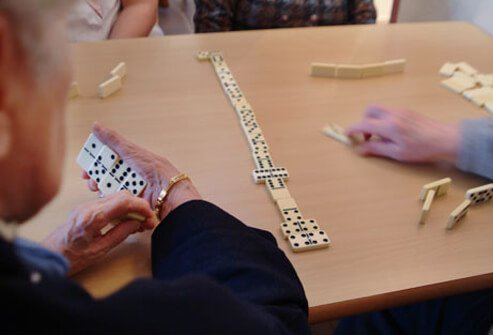 Seniors playing dominos.