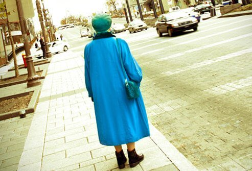 An elderly woman that seems lost in the street.