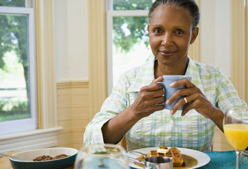 A woman eating breakfast.