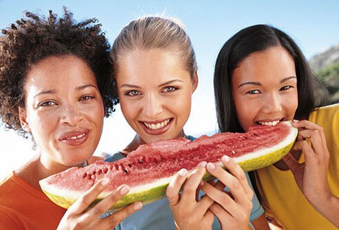 Photo of women sharing skin healthy fruit.