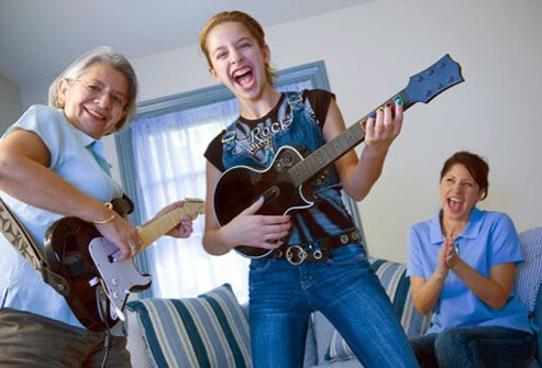 Photo of a senior woman having fun with her granddaughter.