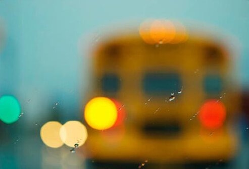 A school bus seen through a windshield.