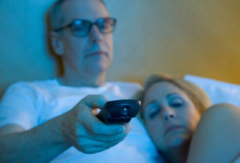 Couple unable to sleep watching late night TV
