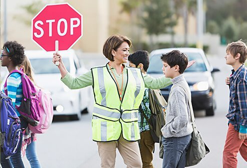 Teach your kids to safely cross the street and wait for a crossing guard.