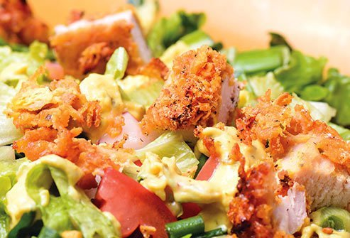 A green salad with chicken may sound like a healthy meal, but descriptions like crispy and crunchy are red flags.