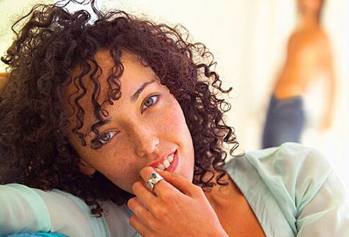 A photo of a woman with very curly hair.
