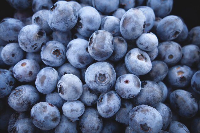 Store unwashed berries in the fridge in a container lined with paper towels to keep them fresh.