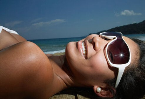 Photo of smiling woman with sunglasses on.