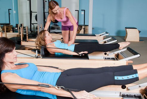 Photo of women doing pilates.