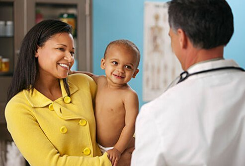 A woman and her baby with a doctor.