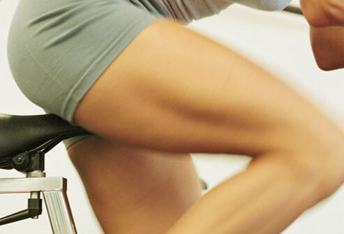 A woman working out on an exercise bike.