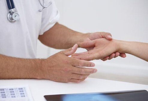 Photo of doctor examining hand.
