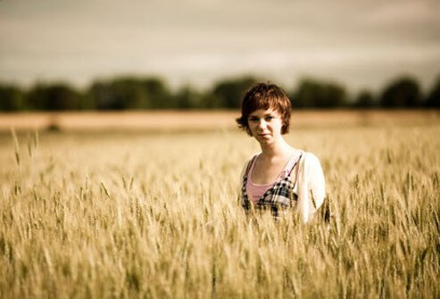 Photo of woman standing in a wheat field.