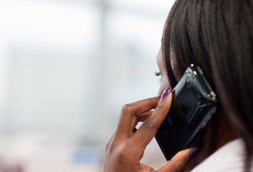 A woman on a mobile phone.