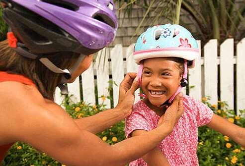 The best thing you can do to protect them from traumatic brain injuries is to get them a well-fitted helmet and instruct them in the rules of the road.