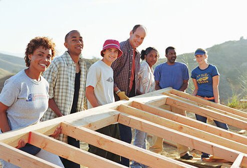 A group of people building a home.