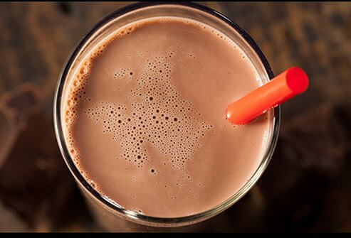 A close up of chocolate milk.