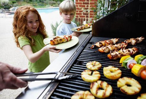 Photo of kids by grill.