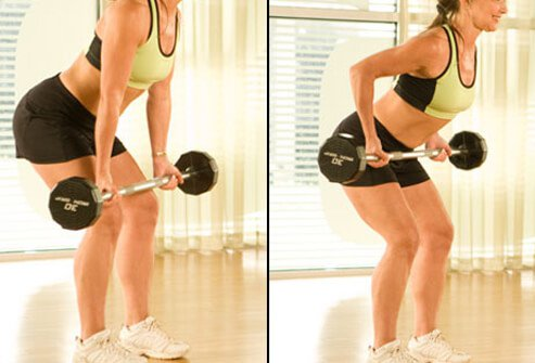 Trainer performing upright row with barbells
